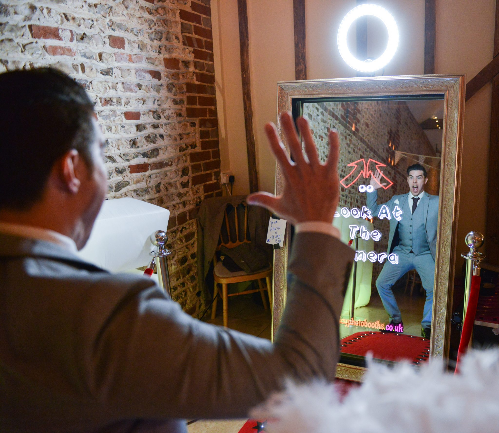 wedding guest posing in magic mirror