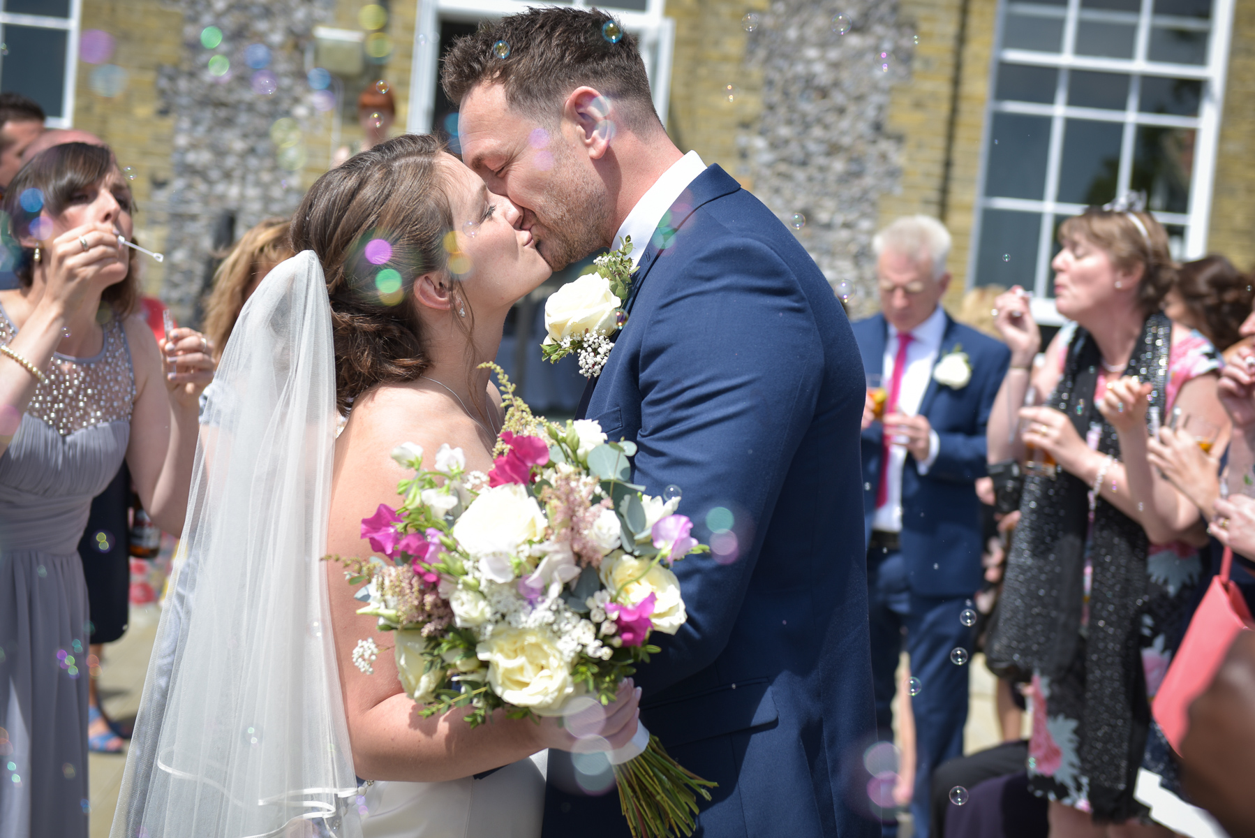 west sussex wedding - couple kissing in bubbles