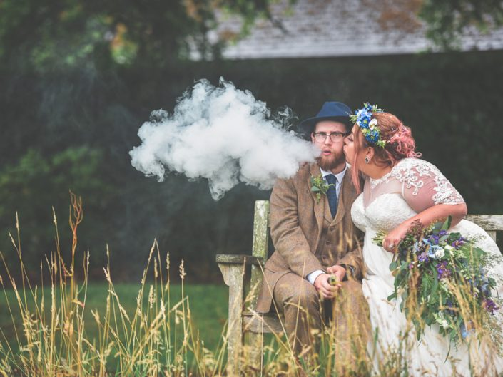 A Rainy outdoor wedding at Nymans Gardens in Surrey - Sussex wedding photographer