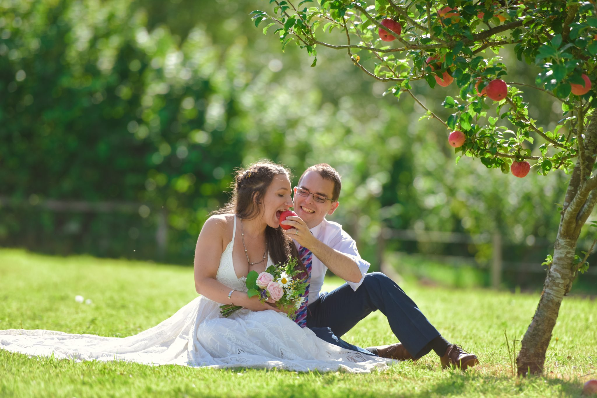 wedding couple under an apple tree, west sussex wedding photographer