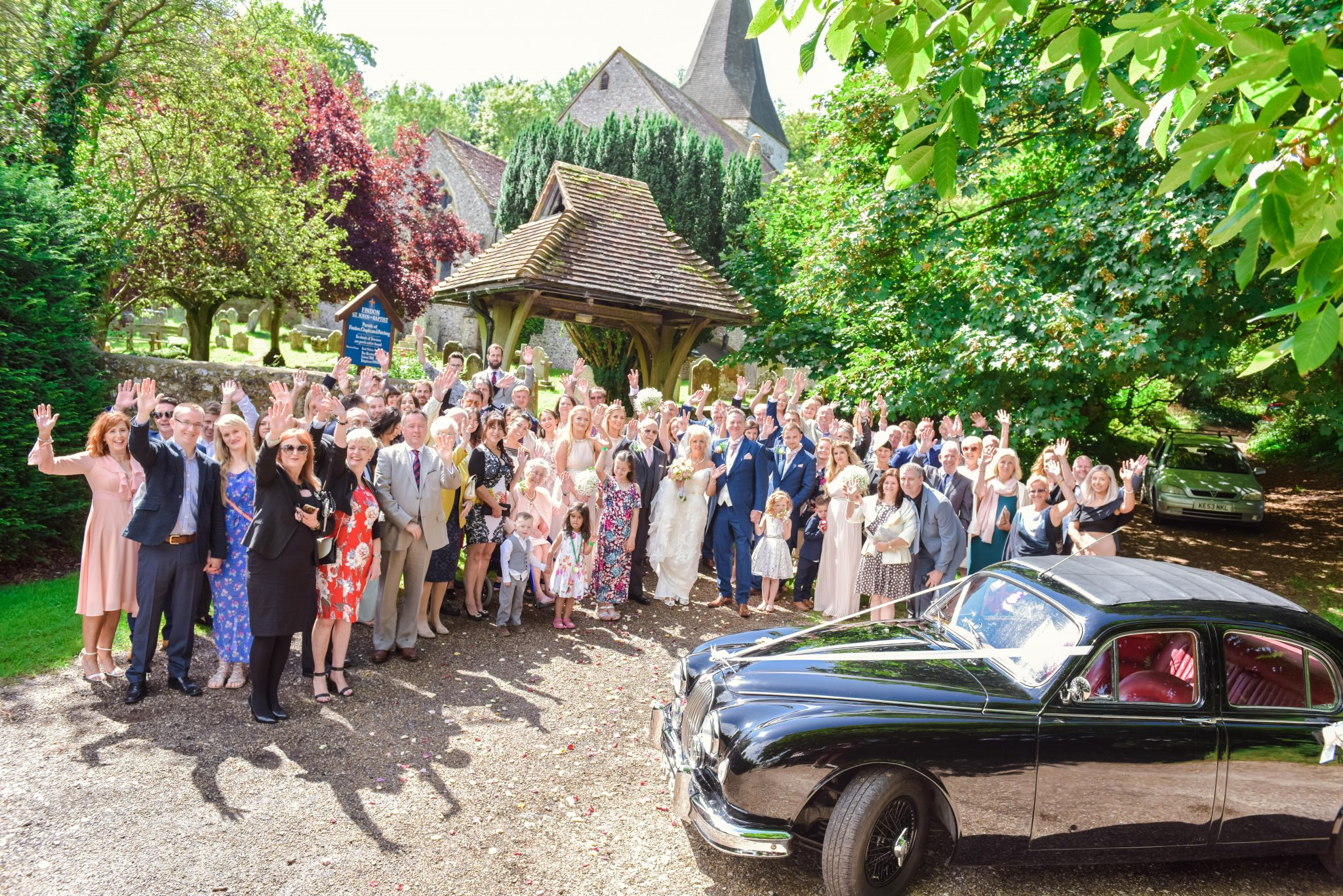 wedding at findon church with black jaguar