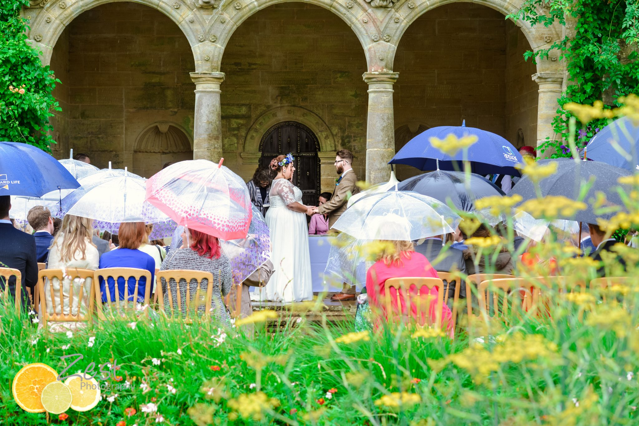 outdoor ceremony in the rain at nymans gardens