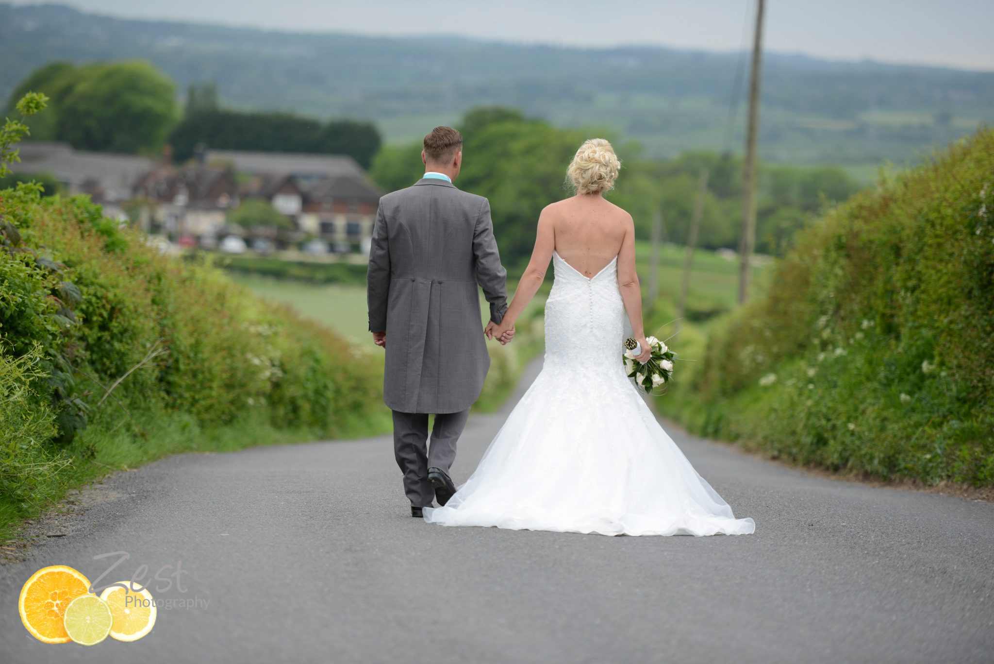 bride and groom walking back to their wedding at tottington manor