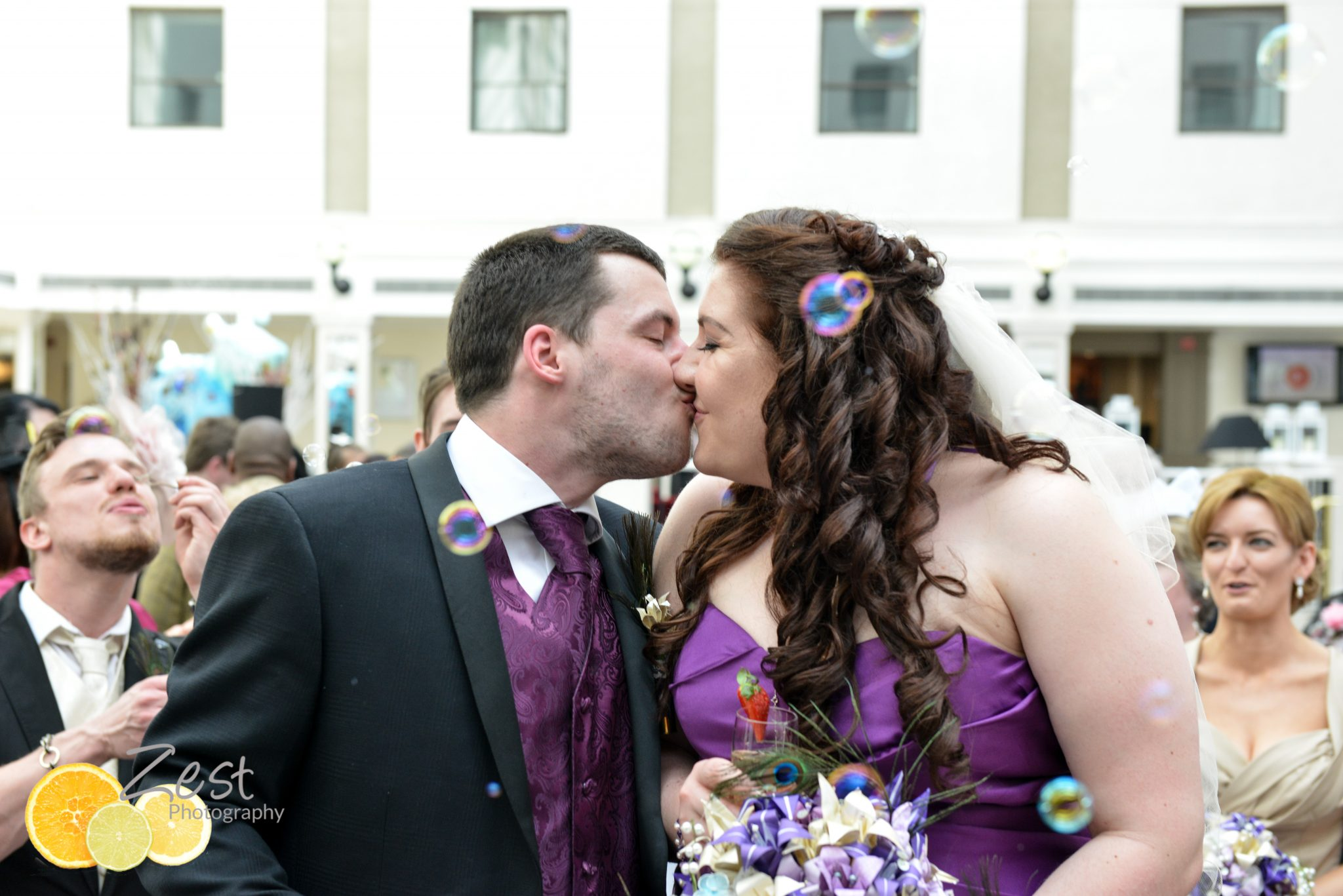 newliwed couple at jurys inn, brighton in purple dress