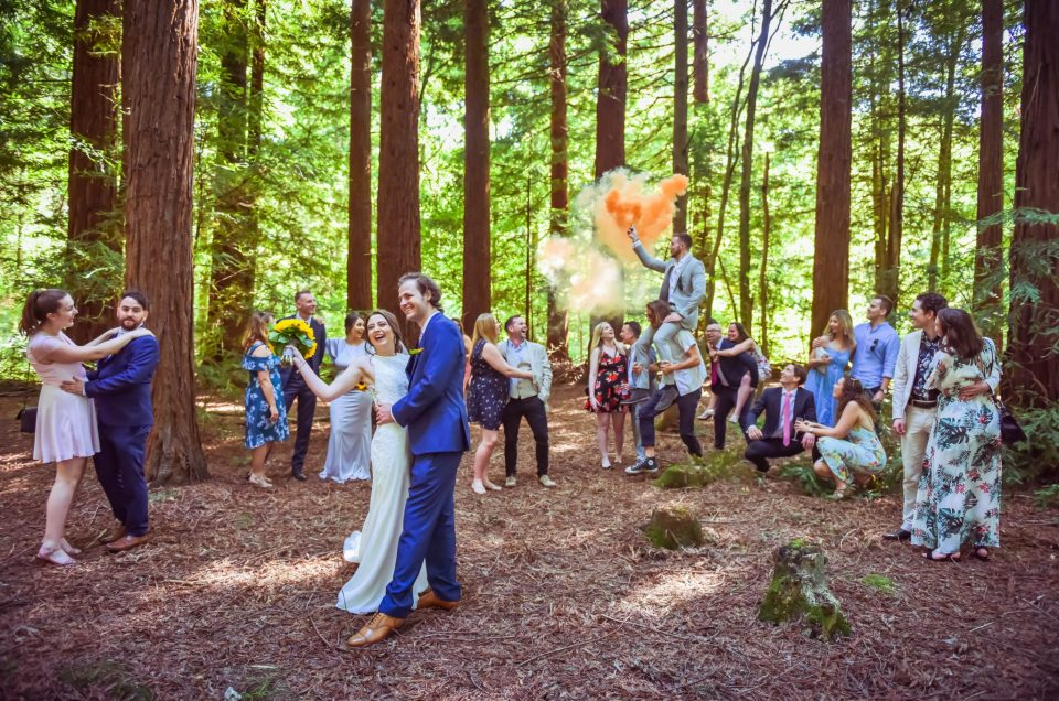 smoke grenade wedding photo at two woods with wedding party
