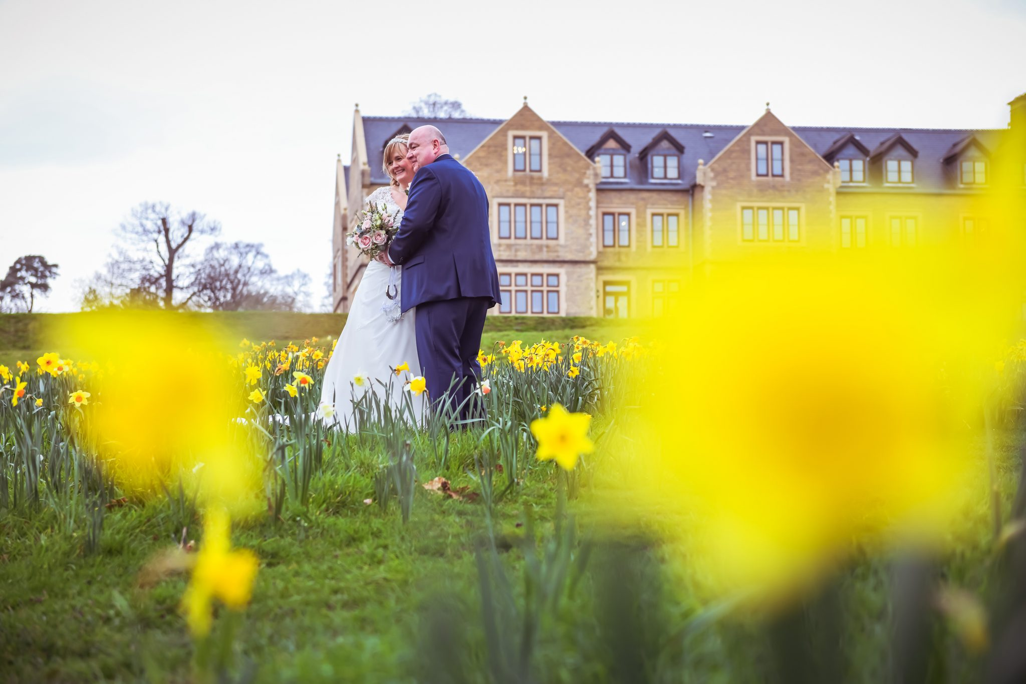 bride and groom in the daffodils