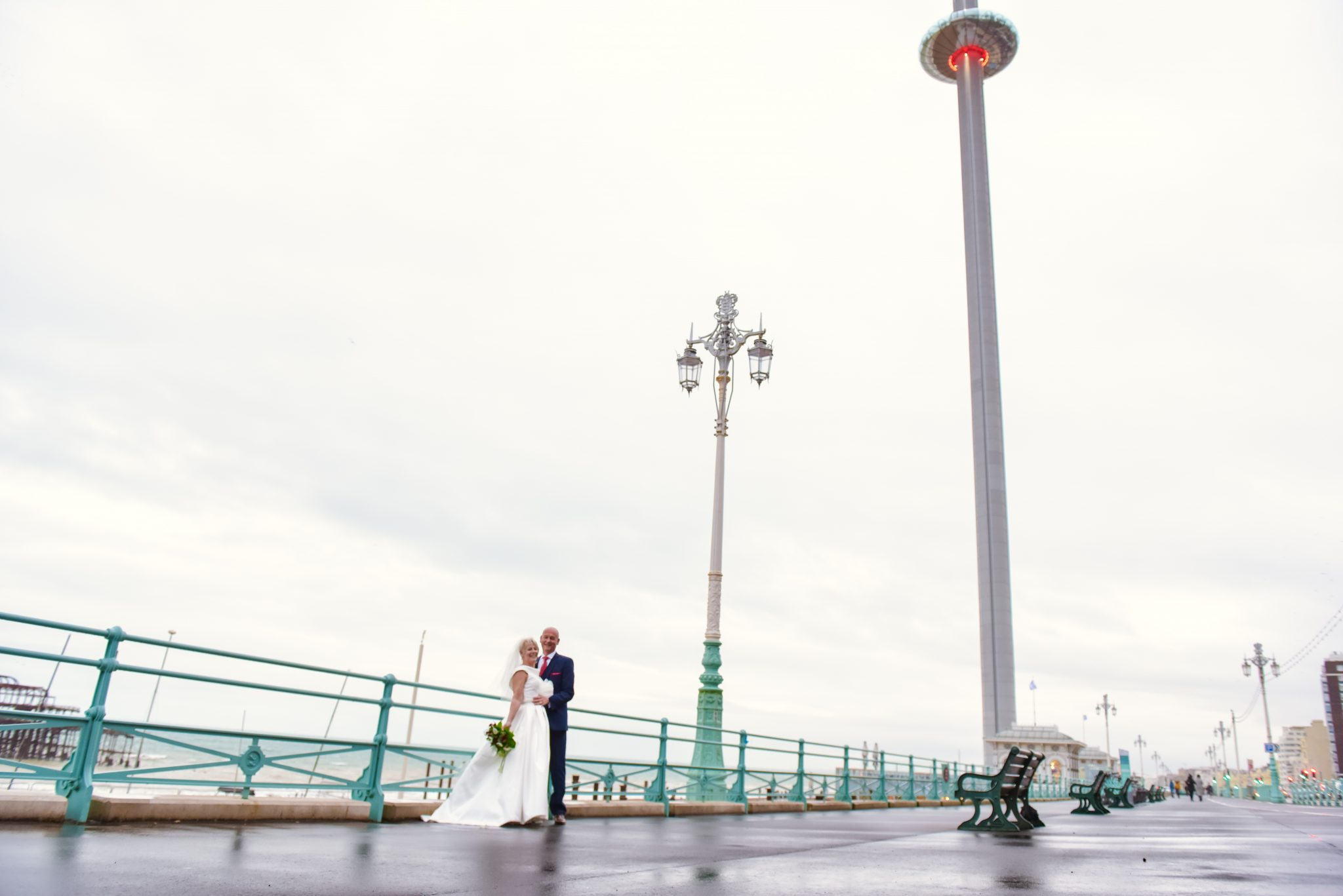 wedding photography in brighton with west pier and bride and groom