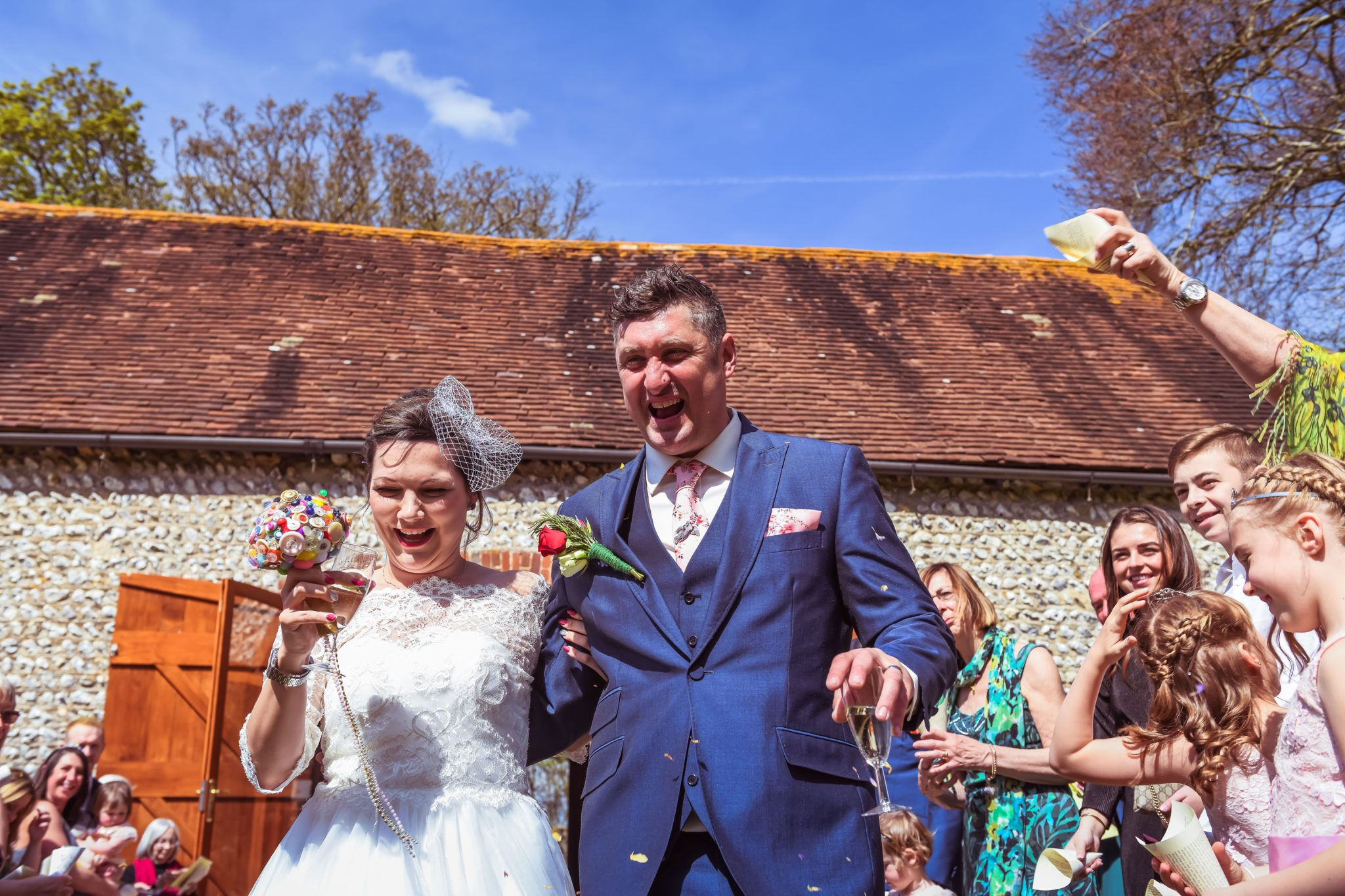 bride and groom during confetti at cissbury barn