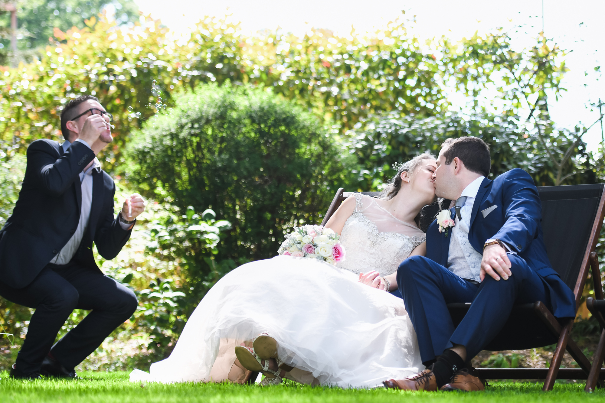 wickwoods country club wedding with couple kissing in deckchair